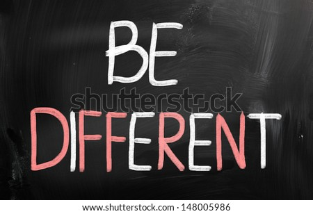 Be different handwritten with chalk on a blackboard - stock photo