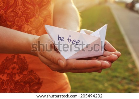 Be free or Sunset background, Paper boat, Way to go - stock photo