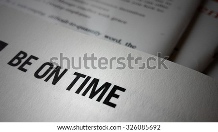 Be on time word on a book. Business success concept