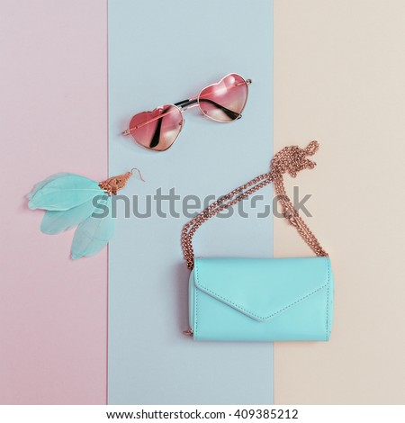 Be Pastel Trend. Fashionable Women's Accessories. Earrings, Sunglasses, Clutch. Detail Fashion - stock photo
