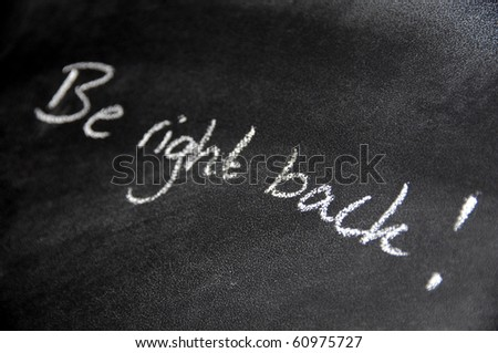 Be right back - handwriting on blackboard