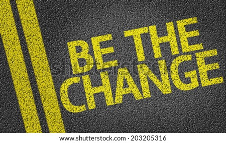 Be The Change written on the road - stock photo