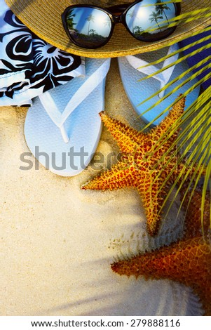 beach accessories on a deserted tropical beach - stock photo