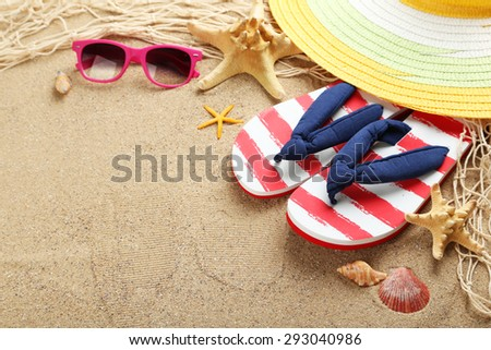 Beach accessories on a sand - stock photo
