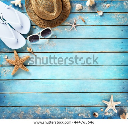 Beach Accessories On Vintage Blue Plank  - stock photo