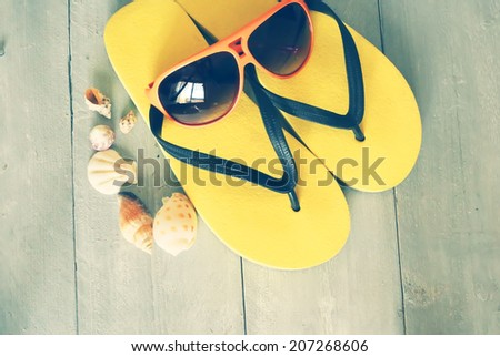 Beach accessories on wooden background - stock photo