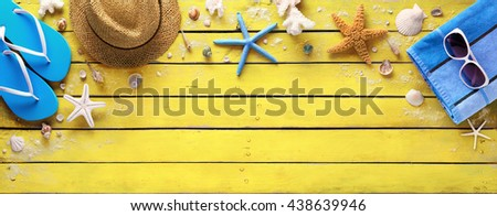Beach Accessories On Yellow Wooden Plank - Summer Holiday  - stock photo