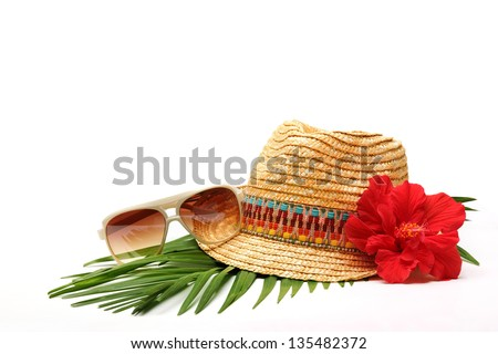 Beach accessories with straw-hat,Sun glasses and flower - stock photo