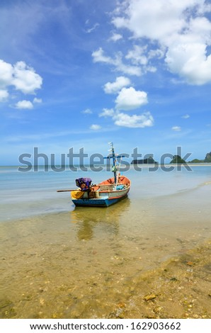 Beach and a fishing boat