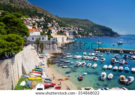 Beach and boats in Dubrovnik from the old town walls, Croatia - stock photo