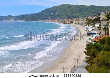 beach and city of of Alassio, Liguria, Italy in early spring - stock photo