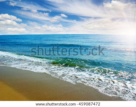 beach and sea on sky