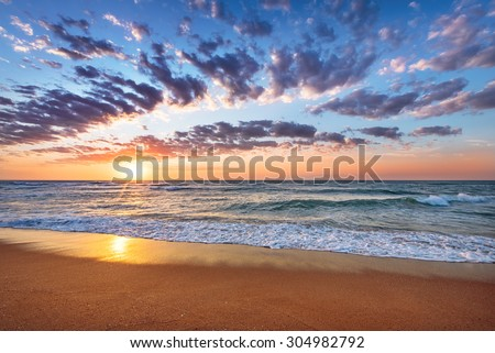 Beach and sea sunrise. - stock photo