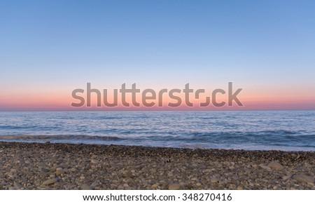 Beach and sunset - stock photo