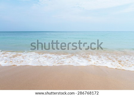 beach and tropical with Sand  and wave - stock photo