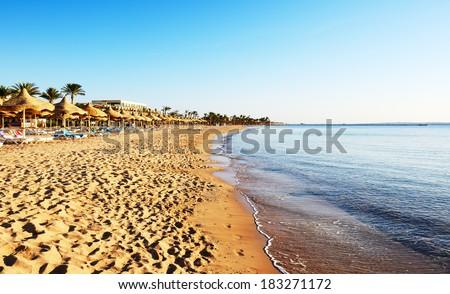 Beach at a luxury hotel, Sharm el Sheikh, Egypt - stock photo
