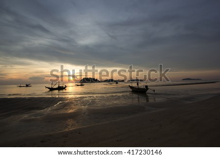 Beach at dawn Filled with fishing boats