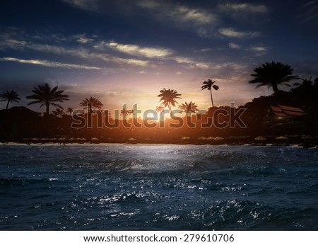 Beach at night in the hotel and the moon - stock photo