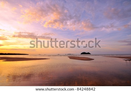 Beach at Sunset Background - stock photo