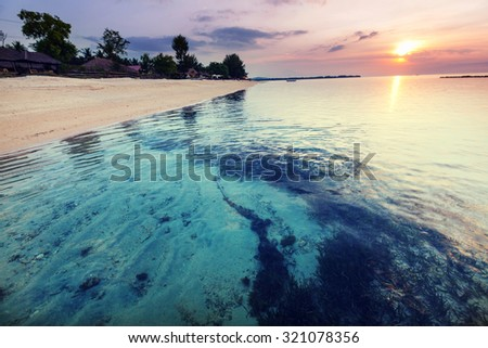 Beach at sunset in Indonesia,Gili island - stock photo