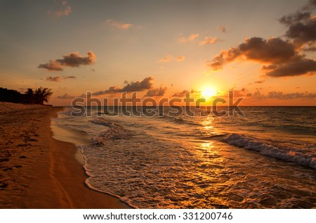 Beach at sunset, Varadero, Cuba - stock photo