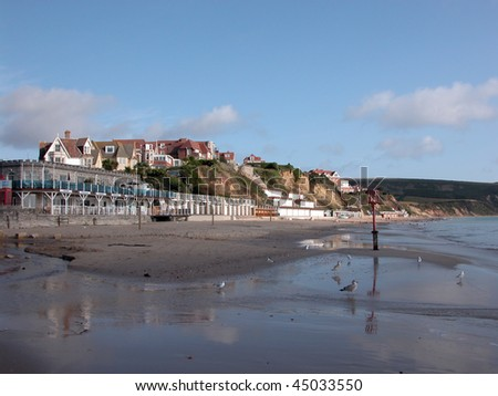 Beach at Swanage in evening light - stock photo
