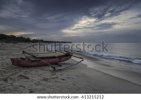 Beach at Waikelo, West Sumba, NTT, Indonesia - March 23, 2017 : Lonely fishermen's boat on the beach