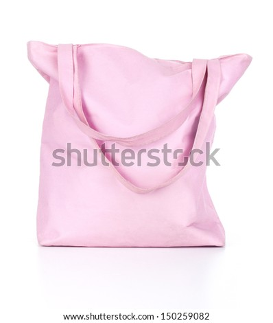 Beach bag with items for a day at the seaside on white background
