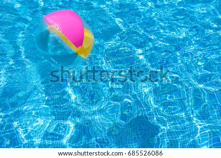Pool Water With Beach Ball beach ball floating blue clear water stock photo 37953973