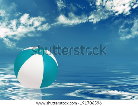 Beach ball in water against cloudy sky - stock photo
