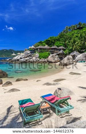 Beach bed on white sand beach at tropical island, Kho Tao, Samui, Thailand - stock photo