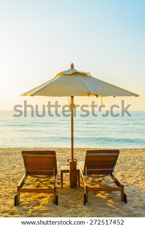 Beach bed with sun flare twilight time - stock photo
