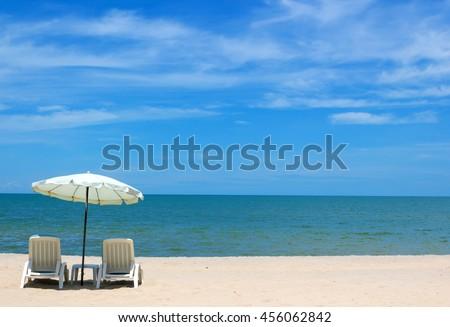 Beach: blue sky and white cloud and ocean, umbrella beach for beach plain relaxing and sun shine beach on a beach for beach background. - stock photo