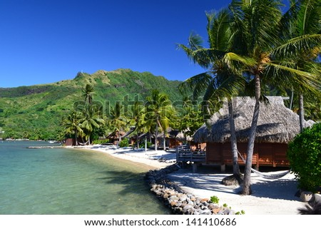 Beach bungalow Tahiti, French polynesia - stock photo