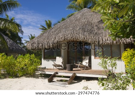 Beach bungalow with deck chairs on a tropical island, Bora Bora, near Tahiti, French Polynesia, Pacific ocean