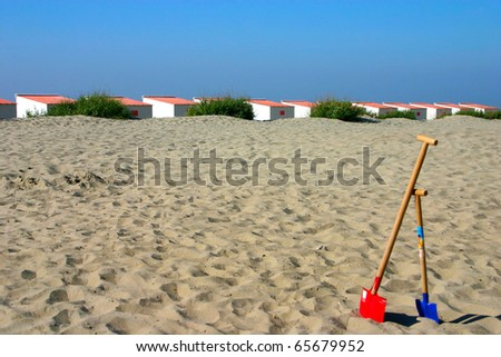 Beach cabins with child spades in the front