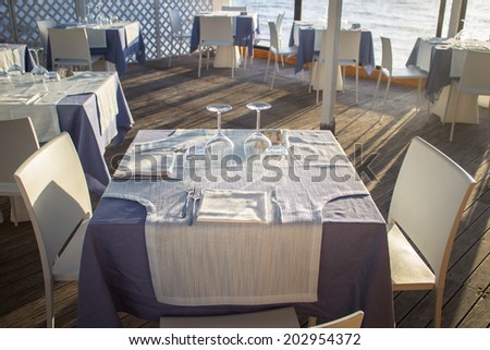 Beach cafe with set table