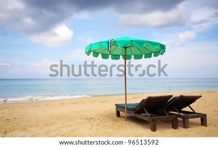 beach chair and green umbrella on the beach , Phuket Thailand