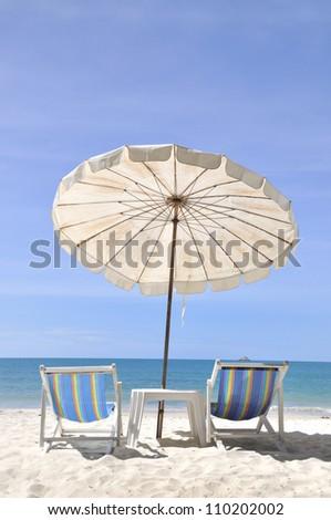 Beach chair and umbrella - stock photo
