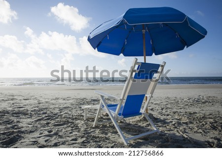 Beach Chair and Umbrella at the Ocean - stock photo