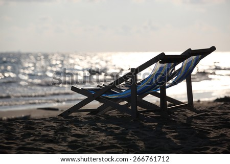 Beach chair on sand beach. Concept for rest, relaxation, holidays, spa, resort. - stock photo