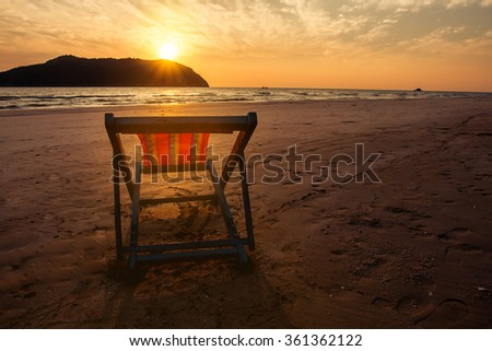 beach chair on sunset beach under warm light. abstract background love summer vacation on the beach.