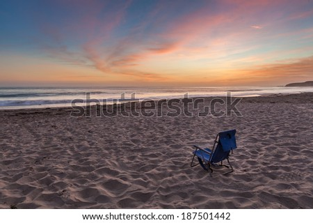 Beach chair on the beach in the evening, Southern California - stock photo