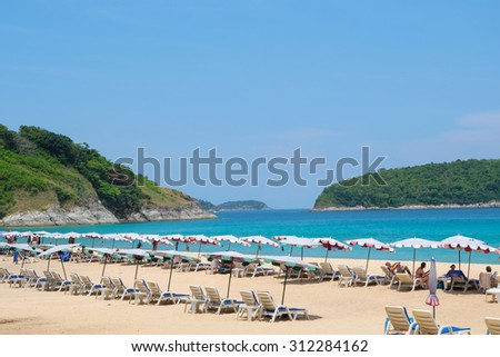 Beach chair with tourist on the beach in sunny day  - stock photo