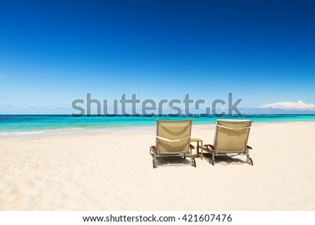 Beach chairs and beautiful sand beach in Punta Cana, Dominican Republic