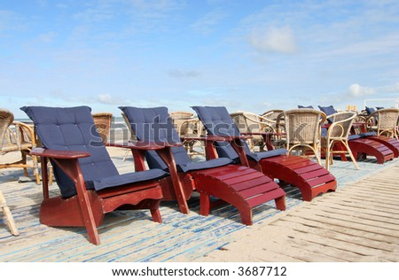 Beach chairs belonging to a seaside restaurant