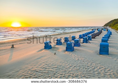 beach chairs in morning light at the baltic sea - stock photo