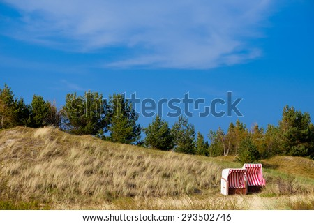 Beach chairs in the dunes - stock photo
