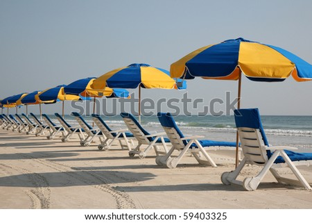 Beach chairs in the sand - stock photo
