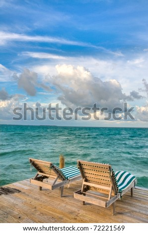Beach Chairs on a Dock Overlooking the Ocean